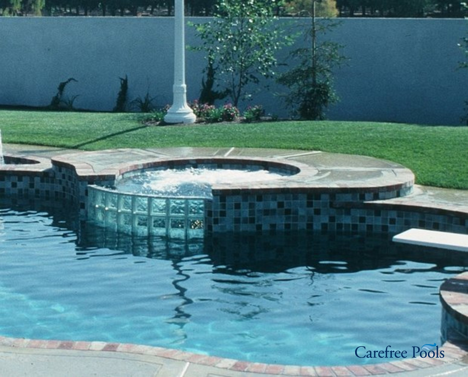 Custom designed inground spas carefree pools for Pool spa show 2016